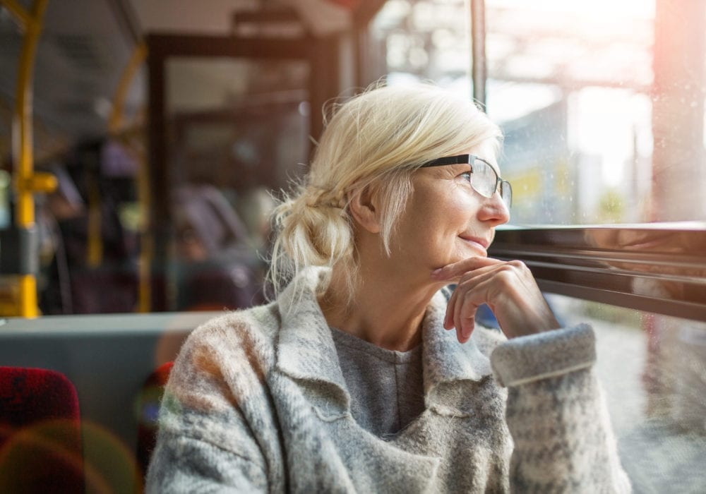 Woman pondering selling her promissory note